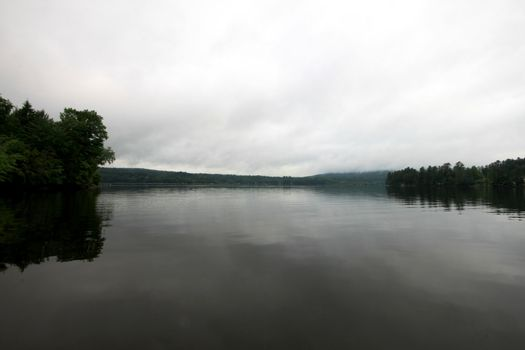 Calm lake Massawippi in the early morning with a bit of fog