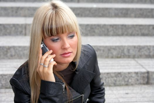 Young woman using mobile phone, looking down