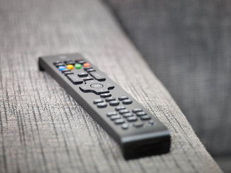 tv remote control on sofa
