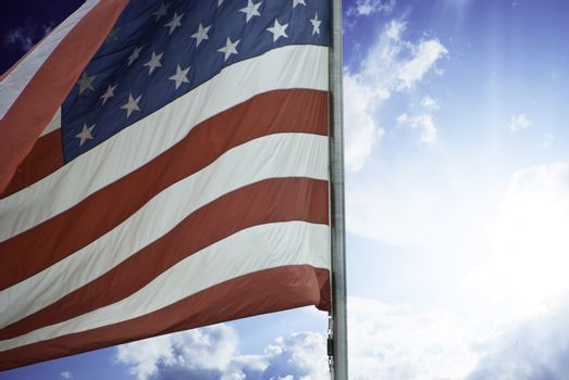 Sun and Clouds over American Flag