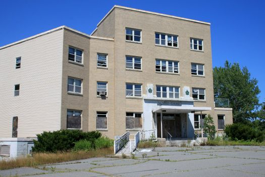 Abandonned hospital with broken windows by vandals