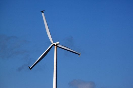 Windmill generating electricity for an industrial complex
