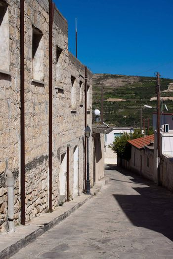 Picture a narrow street in the mountain village