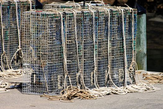 Line of lobster cages on a fishing pier