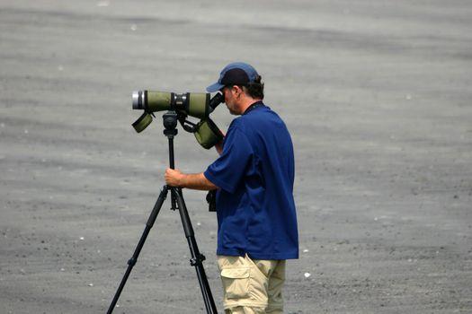 Man doing some bird watching on the beach