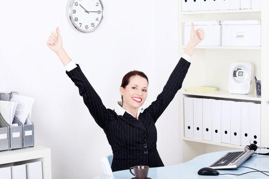Businesswoman gesturing okay sign.