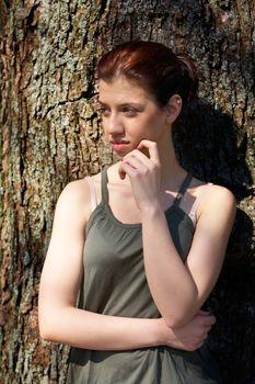 Teenage Girl Leaning to Tree