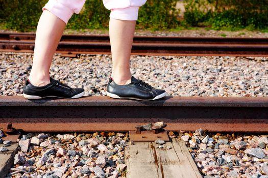 Teenage Girl on Rail