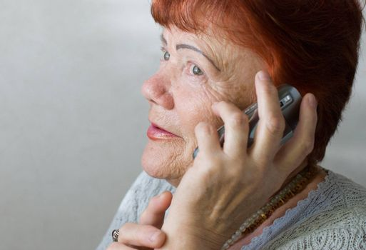Portrait of seventy year old woman with cellphone
