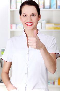 Pharmacist showing okay gesture.