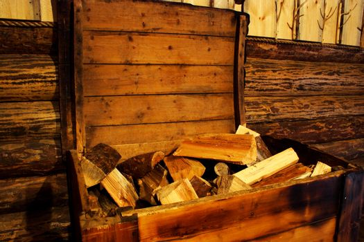 Foto of firewood in old wood chest
