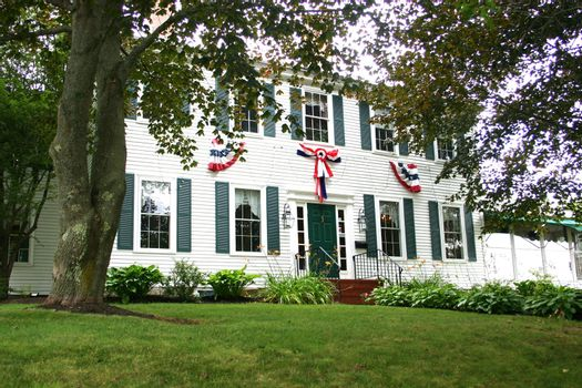Turn of the century american house with patriotic banners