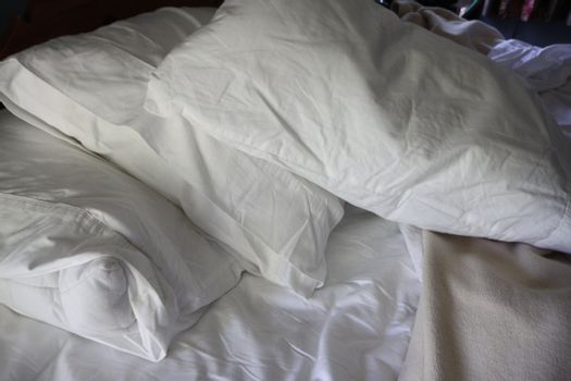 Pillows on a bed after a peacefull night sleep