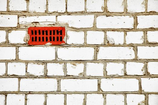 Improvised ventilation on primitive brick wall
