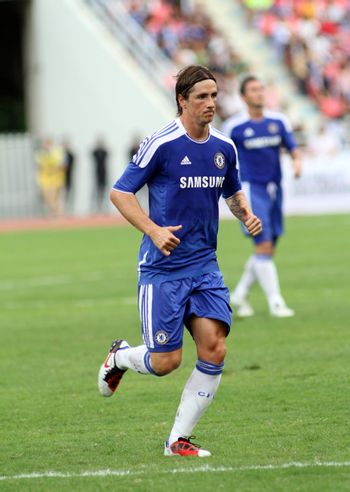 "Bangkok Thailand ,24 July 2011 : Fernando Torres , Chelsea FC' striker and Spain lines-up before a friendly match starting VS Thai Premier League All Star XI at the Rajamangala National Stadium with their Chelsea's ""Here to Play Here to Stay"" 2011campaign"