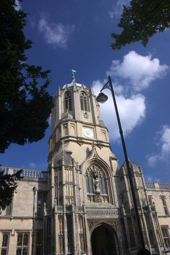 """Main tower of Christ Church, Oxford, UK, named after the bell """"Old Tom"""" it hauses. Christ Church is one of the colleges of Oxford Univeristy and at the same time the Cathedral church of the diocese of Oxford."""