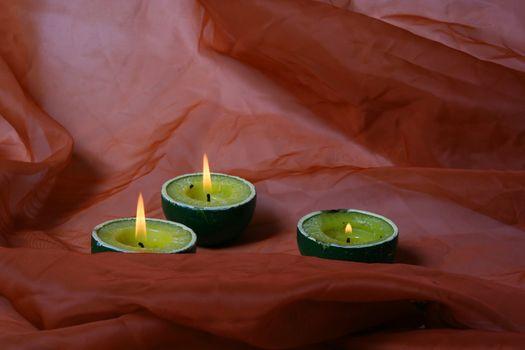 lighting holiday candle illuminated yellow fire background