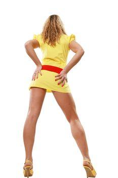 The high long-legged girl in a yellow dress