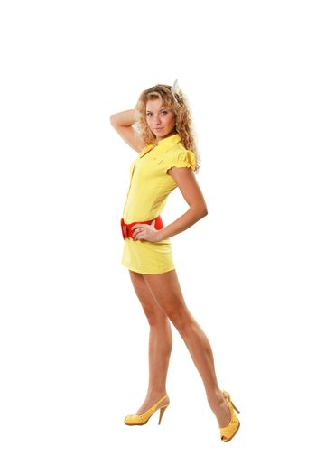 The girl in yellow clothes with a flower in hair