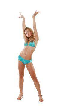 The sexual sports girl in bikini on a white background