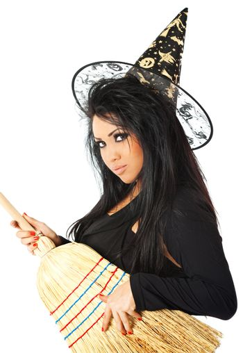 hispanic female in witch costume holding a broom
