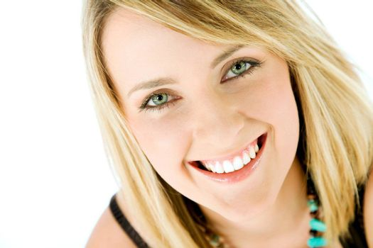 Close-up of happy blond female face smiling, looking at camera, isolated