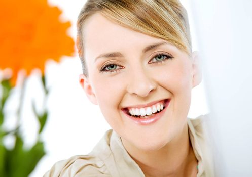 Portrait of beautiful smiling happy blond business woman, looking at camera