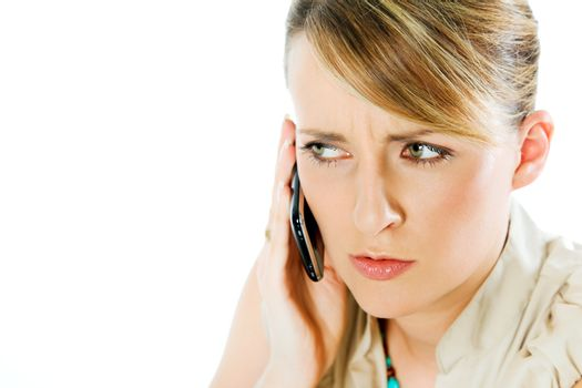 face of beautiful blond woman talking on the phone, looking worried