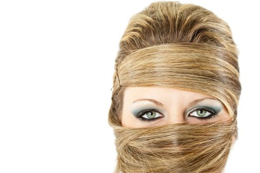 Fashion portrait of blonde female with excentric hairstyle all over her face
