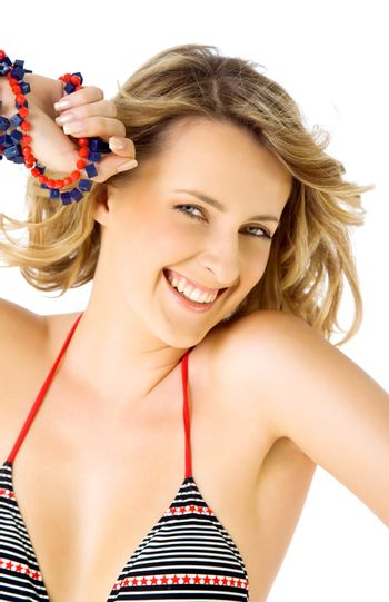 beautiful happy blond female with swimsuit, smiling at camera on white background