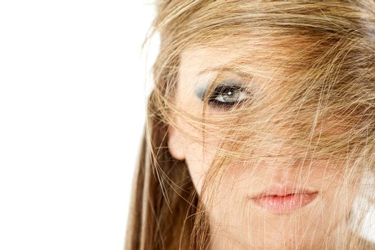Close-up of blonde woman with hair all over her face, isolated on white