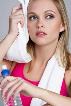 Fitness woman water bottle towel