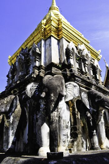 An old temple in Chiang Mai, Thailand with statues of Elephants