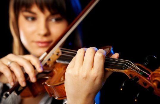 blurred female violinist