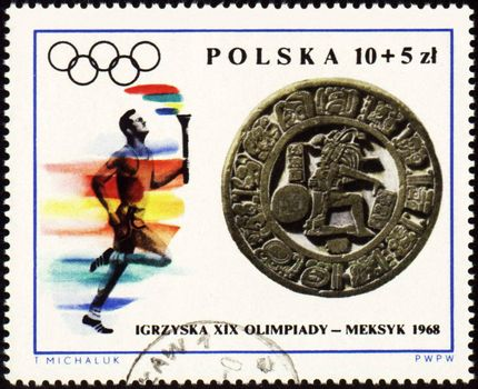 POLAND - CIRCA 1968: A post stamp printed in Poland shows sportsman with torch, devoted to Olympic games in Mexico, series, circa 1968