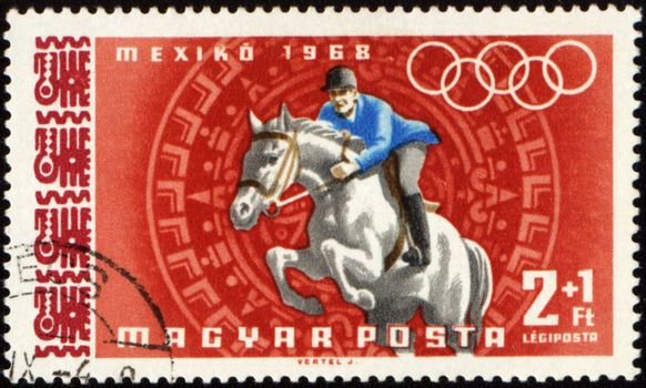 HUNGARY - CIRCA 1968: A post stamp printed in Hungary shows jockey riding horse, devoted to Olympic games in Mexico, series, circa 1968