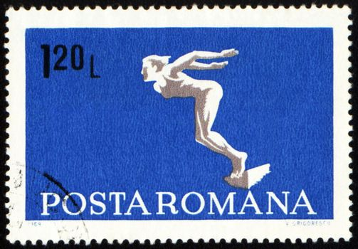 ROMANIA - CIRCA 1969: A post stamp printed in Romania shows diving swimmer, series, circa 1969