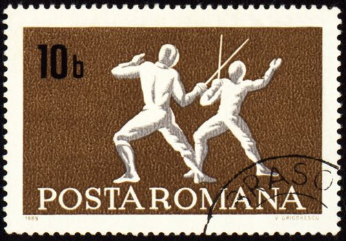 ROMANIA - CIRCA 1969: A post stamp printed in Romania shows fencing, series, circa 1969