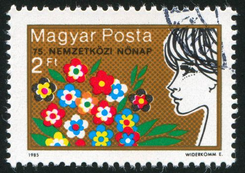 HUNGARY - CIRCA 1985: stamp printed by Hungary, shows Flowers and Woman, circa 1985