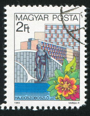 HUNGARY - CIRCA 1983: stamp printed by Hungary, shows Hotel Hajduszoboszlo and Flower, circa 1983