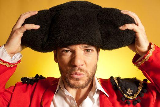 Bullfighter putting on big montera hat humor spanish colors