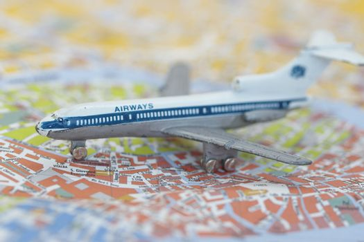Toy Airplane on map of venice, Shallow depth of field from use of macro lens.