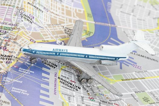 Toy Airplane on map of New York. Shallow depth of field from use of macro lens