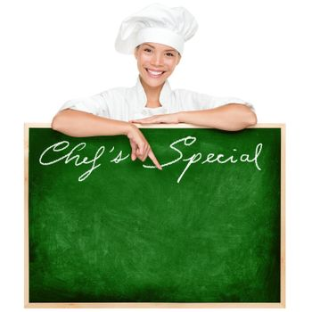 Chef menu sign blackboard with copy space for menu items. Beautiful young woman chef holding showing blank chefs special restaurant menu chalkboard isolated on white background. Multiracial Chinese Asian / Caucasian female cook or chef.