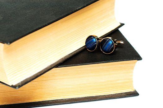 Cufflinks lying on the book