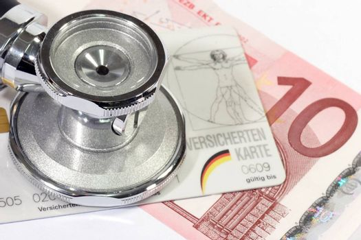 Stethoscope with insurance card and euro banknote