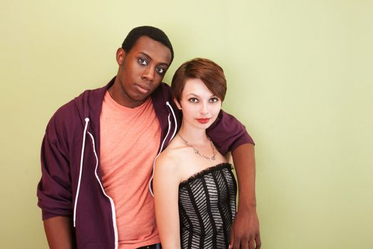 Mixed race couple stare at the camera