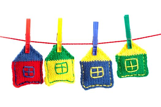 four knitted colorful houses