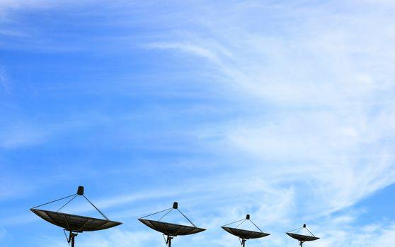black antenna communication satellite dish over blue sky