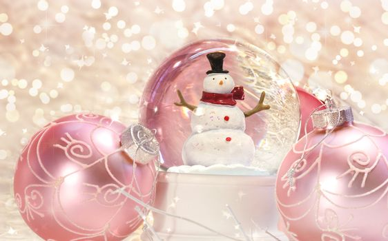 Snow globe with pink ornaments